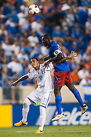 Haiti midfielder Jean-Marc Alexandre (16) goes up for a header over Honduras midfielder Rony Martinez (11). Honduras defeated Haiti 2-0 during a CONCACAF Gold Cup group B match at Red Bull Arena in Harrison, NJ, on July 8, 2013.