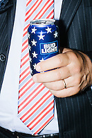 A man holds an American flag-themed can of Bud Light beer on the final day of the Democratic National Convention at the Wells Fargo Center in Philadelphia, Pennsylvania, on Thurs., July 28, 2016.