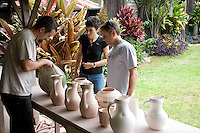 Tourists viewing pottery made by local artist at Hui No'eau Visual Arts Center in upcountry Maui
