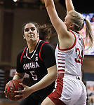 SIOUX FALLS, SD - MARCH 9: Elena Pilakouta #5 of the Omaha Mavericks drives into Hannah Sjerven #34 of the South Dakota Coyotes during the 2021 Women's Summit League Basketball Championship at the Sanford Pentagon in Sioux Falls, SD. (Photo by Richard Carlson/Inertia)