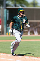 Oakland Athletics outfielder Nick Osborne (7) hustles down the first base line during an Instructional League game against the Los Angeles Dodgers at Camelback Ranch on September 27, 2018 in Glendale, Arizona. (Zachary Lucy/Four Seam Images)