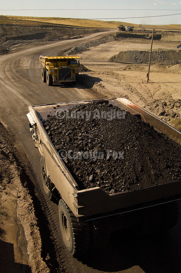 Black Thunder coal mine trucks--Komatsu and Leibherr-- haul coal from the mine to the rail coaling station for shipment to power plants in the Midwest