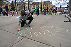 March 22, 2021; At the close of the #BondOnBond presentation, students from  Fr. Kevin Sandburg's class chalk a message on the sidewalk in front of Bond Hall. The students addressed the effects of the pandemic on campus life such as isolation, loneliness, their difficulty at bonding, etc. The cast represent brokenness and healing.  (Photo by Barbara Johnston/University of Notre Dame)