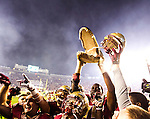 The Florida State Seminoles hoist the gator head to celebrate in front of the student section after in an NCAA football game against Florida in Tallahassee, November 29, 2014.  The Florida State Seminoles defeated the Florida Gators 24-19.