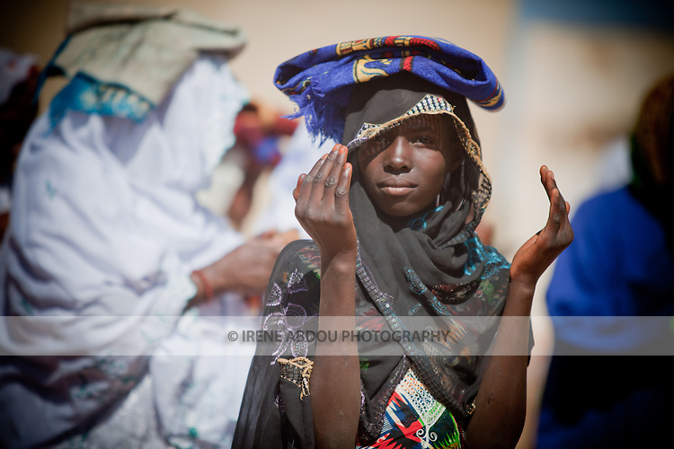 On the morning of Tabaski, men, women, and children alike converge on the great mosque of Djibo in northern Burkina Faso for a special Tabaski prayer.  At the end of the prayer, a Fulani girl holds up her hands, asking for blessing and forgiveness.  This part of the country is primarily Muslim, inhabited mainly by the Fulani and Touareg, both traditionally pastoralist ethnic groups, crisscrossing the Sahel and Sahara with their cattle and other livestock, in search of green pastures and fresh water.