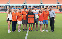 HOUSTON, TX - SEPTEMBER 10: Katie Naughton #25 of the Houston Dash receives a number 100 jersey for her 100th start in a NWSL game with her family and James Clarkson in attendance before a game between Chicago Red Stars and Houston Dash at BBVA Stadium on September 10, 2021 in Houston, Texas.