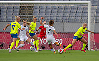 TOKYO, JAPAN - JULY 21: Tobin Heath #7 of the USWNT shoots during a game between Sweden and USWNT at Tokyo Stadium on July 21, 2021 in Tokyo, Japan.