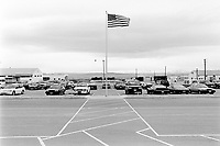 Usa. Utah. Tooele county. Deseret chemical depot. American flag and parking for the cars. Tooele chemical agent disposal facility (TOCDF). Program for destruction of chemical weapons and agent. Deseret chemical depot is distant 100 km from Salt Lake City. The Deseret Chemical Depot is one of eight Army installations in the U.S. that currently store chemical weapons. The weapons originally stored at the depot consisted of various munitions and ton containers, containing GB and VX nerve agents or H, HD, and HT blister agent. The Tooele Chemical Agent Disposal Facility is designed for the sole purpose of destroying the chemical weapons stockpile located at the depot. © 1998 Didier Ruef