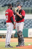 Houston Astros minor league catcher Ben Heath talks with pitcher Jose Montero (63) vs. the Atlanta Braves during an Instructional League game at Osceola County Stadium in Kissimmee, Florida;  October 14, 2010.  Photo By Mike Janes/Four Seam Images