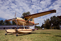 Cessna 185 on floats, N4833C on floats, parked at the Natural High School during the Clear Lake Seaplane Splash-In, Lakeport, Lake County, California
