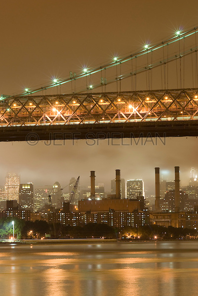 East River, Willliamsburg Bridge, Electric Power Plant and Manhattan Skyline on an Overcast, Cloudy Night