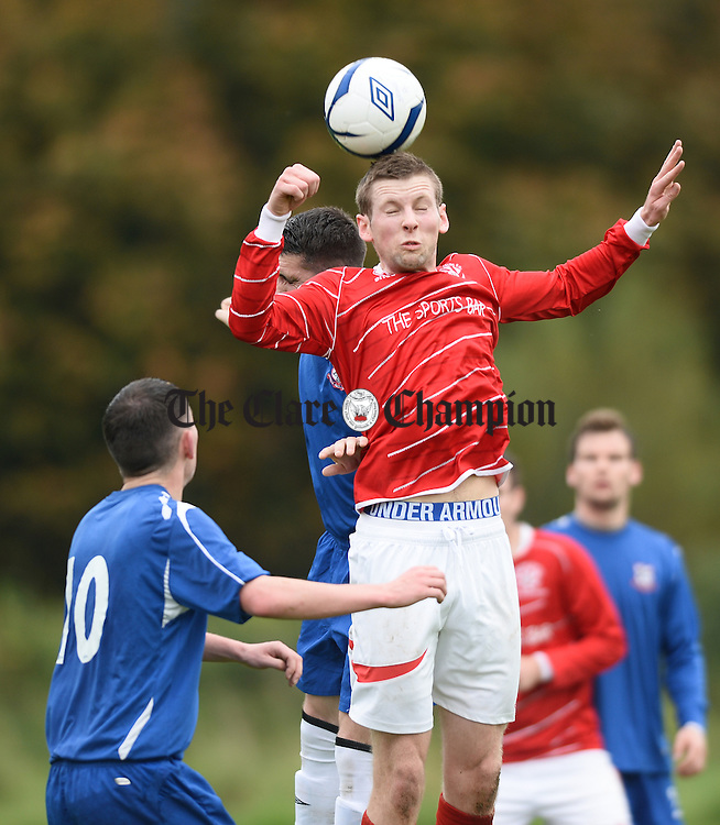 Colin Smyth of Newmarket A in action against Jason Whyte of Bridge United A  during their clash at Shannon. Photograph by John Kelly.