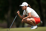 CHON BURI, THAILAND - FEBRUARY 18:  In Kyung Kim of South Korea lines up a putt on the 2nd gree during day two of the LPGA Thailand at Siam Country Club on February 18, 2011 in Chon Buri, Thailand. Photo by Victor Fraile / The Power of Sport Images
