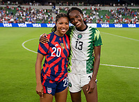 AUSTIN, TX - JUNE 16: Margaret Purce #20 of the USWNT and Ifeoma Onumonu #13 of Nigeria pose for a photo during a game between Nigeria and USWNT at Q2 Stadium on June 16, 2021 in Austin, Texas.