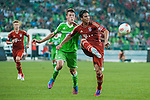 Claudio Pizarro of Bayern Munich and  Robin Knoche of VfL Wolfsburg in action during a friendly match as part of the Audi Football Summit 2012 on July 26, 2012 at the Guangdong Olympic Sports Center in Guangzhou, China. Photo by Victor Fraile / The Power of Sport Images