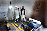 31 May 2013, Banda Miralamji Village, Surkhrod district, Jalalabad, Afghanistan.  Banda Miralamji village Community Development Council (CDC)  chairman Saied Rafiq (52 at right) and vice chair Sayed Abdul Ghafar (53)  showing the Micro Hydro power facilities built using funds from the National Solidarity Program (NSP). The micro hydro power generates electricity for the village from canal water, allowing the residents the opportunity to use things such as mobile phone chargers, washing machines and light globes. The NSP is the Governments national flagship program to support small scale reconstruction and development activities identified by CDC's across the country.About 80% of community sub projects involve infrastructure such as irrigation, roads and electricity all critical for the recovery of the rural economy and governance.The ministry of Rural Rehabilitation and Development is implementing the program. Picture by Graham Crouch/World Bank