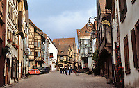 Riquewihr: Main Street. Fire company rehearsal. Old, charming unchanged town since Middle Ages. Alsace region of France.