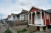 Dilapidated houses in Jaywick Sands, Essex.  Many of the seaside chalets, originally built as holiday homes, are now being used as permanent housing, privately rented to benefit claimants.