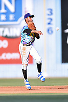 Asheville Hippies shortstop Carlos Herrera (2) throws the ball to second base during a game against the Greenville Drive at McCormick Field on June 29, 2017 in Asheville, North Carolina. The Drive defeated the Tourists 9-6. (Tony Farlow/Four Seam Images)