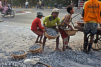 Children hump stones as they build a road on the outskirts of Mandalay, Burma November 08.  Child labour is a normal in Burma.<br />