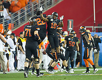 STANFORD, CA - January 2, 2012: Oklahoma State players James Thomas (22) and Brodrick Brown (19) celebrate a touchdown at the Fiesta Bowl at University of Phoenix Stadium in Phoenix, AZ. Final score Oklahoma State wins 41-38.