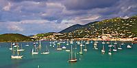 Saint Thomas Charlotte Amalie town hills, with myriads of sailboats on the turquoise sea, in British Virgin Island (BVI), Caribbean Leeward Islands