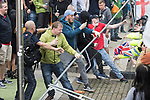 """© Joel Goodman - 07973 332324 . 11/06/2017 . Manchester , UK . Demonstrators tear down barriers designed to contain the demonstration . Demonstration against Islamic hate , organised by former EDL leader Tommy Robinson's """" UK Against Hate """" and opposed by a counter demonstration of anti-fascist groups . UK Against Hate say their silent march from Piccadilly Train Station to a rally in Piccadilly Gardens in central Manchester is in response to a terrorist attack at an Ariana Grande concert in Manchester , and is on the anniversary of the gun massacre at the Pulse nightclub in Orlando . Photo credit : Joel Goodman"""