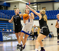 Camiran Brockhoff (3) goes up for layup with Claudia Bridges (1) and Carly Johnson (22) of Fayetteville defend  of Rogersat King Arena, Rogers, AR January 8, 2021 / Special to NWA Democrat-Gazette/ David Beach