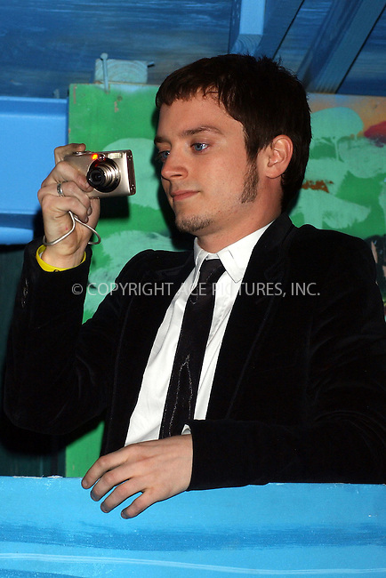 WWW.ACEPIXS.COM . . . . . ....NEW ORLEANS, FEBRUARY 26, 2006....Elijah Wood on top of a float at the Bacchus Parade in New Orleans.....Please byline: KRISTIN CALLAHAN - ACEPIXS.COM.. . . . . . ..Ace Pictures, Inc:  ..Philip Vaughan (212) 243-8787 or (646) 679 0430..e-mail: info@acepixs.com..web: http://www.acepixs.com