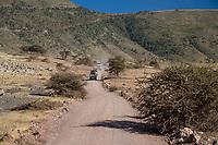 Tanzania. Ngorongoro Crater.  Vehicles Coming down Entrance Road into Crater.
