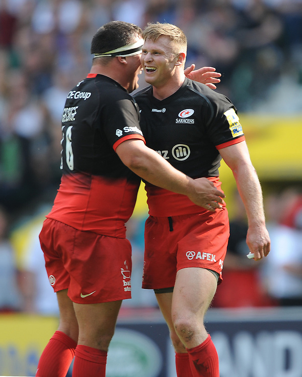 Chris Ashton and Jamie George of Saracens celebrate after winning the Aviva Premiership Rugby Final between Saracens and Exeter Chiefs at Twickenham Stadium on Saturday 28th May 2016 (Photo: Rob Munro/Stewart Communications)