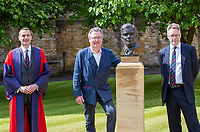 BNPS.co.uk (01202) 558833. <br /> Pic: CorinMesser/BNPS<br /> <br /> Pictured: Sherborne School headmaster Dr Dominic Luckett, Turing's nephew and fellow Sherborne School alumni, author Sir John Dermot Turing and sculptor David Williams-Ellis with the bust. <br /> <br /> A magnificent bronze bust of Enigma codebreaker Alan Turing has today gone on display at his former school.<br /> <br /> The bust, which is just over life size, stands on a plinth at Sherborne School in Dorset, where the genius mathematician and father of computer science was a pupil from 1926 to 1931.<br /> <br /> It was unveiled by Turing's nephew and fellow Sherborne School alumni, author Sir John Dermot Turing.<br /> <br /> During the Second World War Turing worked for the Government Code and Cypher School (GC&CS) at Bletchley Park, Bucks, Britain's code-breaking centre. He played a pivotal role in cracking the German Enigma code that enabled the Allies to defeat the Nazis in many crucial battles.<br /> <br /> The bust has been fashioned by acclaimed sculptor David Williams-Ellis, who has previously commemorated the D-Day landings in sculpture for the Normandy Memorial Trust.