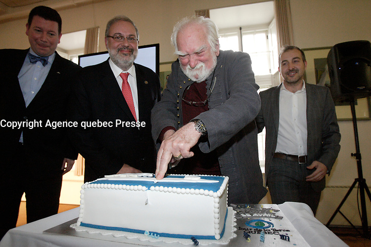 Montreal (Qc) CANADA - April 10 2012 File Photo - <br /> Pierre Arcand, Quebec Environment Minister (L) and Jacques Languirand (R) cut the cake for <br /> Earth Day - Jour de la Terre