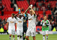 Pictured: Jonjo Shelvey of Swansea thanks supporters after the final whistle. Saturday 16 August 2014<br />