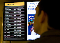 Passenger info at Glasgow Internationl Airport after the.ban on flights to and from Scottish airports has been reinstated over fears of the danger to aircraft from a cloud of volcanic ash..All non-emergency air traffic was grounded on Thursday because of the eruption in Iceland..Restrictions were lifted in Scotland as the cloud moved south on Friday..But air traffic control body Nats has restricted UK airspace until at least 0100 BST on Sunday. A small number of Scottish domestic flights may take off. .17 April 2010 Picture: Universal News And Sport (Europe)...