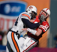 01 January 2007: Nebraska quarterback Zac Taylor (#13) is hit hard by Auburn defensive end Quentin Groves (#54) during the 2007 AT&T Cotton Bowl Classic between The University of Auburn and The University of Nebraska at The Cotton Bowl in Dallas, TX.