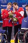 Sochi, RUSSIA - Mar 15 2014 - Derek Whitson and Kevin Rempel examine their Bronze medals in Sledge Hockey at the 2014 Paralympic Winter Games in Sochi, Russia.  (Photo: Matthew Murnaghan/Canadian Paralympic Committee)