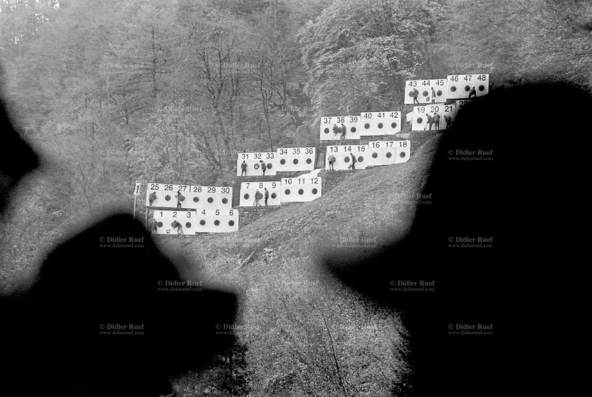 Switzerland. Canton Uri. Rütli. A group of and women men count the points on the 48 targets by using various colorful sticks during the Rütlischiessen (Rütli shooting). Outdoor shooting range. Shadows of riflemen wearing hats on heads. Rütli or Grütli is a mountain meadow overlooking the lake Lucerne where the oath of the Rütlischwur for the forming of the Old Swiss Confederacy is said to have occurred as the legendary turning-point in the pursuit of independence. To commemorate this historic event, the riflemen's association of Lucerne organized the Rütli rifle match (Rütlischiessen) in 1862. It is held every year on the Wednesday before Martinmas (Saint Martin's Day). Thousand competitors from all over Switzerland fire their fifteen shots at targets arranged on a cliff.  8.11.2017 © 2017 Didier Ruef