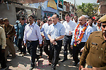 12 March 2013, Kanpur, Uttar Pradesh India: President of the World Bank, Mr Jim Yong Kim walks the streets during his visit to the low income suburb of Gwaltoli  on his tour of Kanpur in Uttar Pradesh state, India. Mr.Kim is visiting India  for meetings with local staff, Indian Government Ministers and to inspect projects sponsored by World Bank in regional areas. Picture by Graham Crouch/World Bank