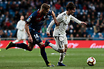 Real Madrid's Alvaro Odriozola and SD Huesca's Jorge Pulido during La Liga match between Real Madrid and SD Huesca at Santiago Bernabeu Stadium in Madrid, Spain. March 31, 2019. (ALTERPHOTOS/A. Perez Meca)