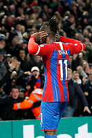 GOAL - Wilfried Zaha of Crystal Palace cups his ears after his goal during the Premier League match between Crystal Palace and Brighton and Hove Albion at Selhurst Park, London, England on 16 December 2019. Photo by Carlton Myrie / PRiME Media Images.
