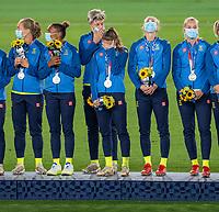 YOKOHAMA, JAPAN - AUGUST 6: Sweden stands on the podium at International Stadium Yokohama on August 6, 2021 in Yokohama, Japan.