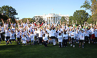 """Kids jump up in front of the White House during a  D.C United clinic in support of first lady Michelle Obama's """"Let's Move"""" initiative on the White House lawn, in Washington D.C. on October 7 2010."""