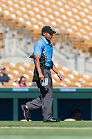 Home plate umpire Jeremie Rehak walks towards the pitcher's mound during an Arizona Fall League game between the Mesa Solar Sox and the Glendale Desert Dogs at Camelback Ranch on October 15, 2018 in Glendale, Arizona. Mesa defeated Glendale 8-0. (Zachary Lucy/Four Seam Images)