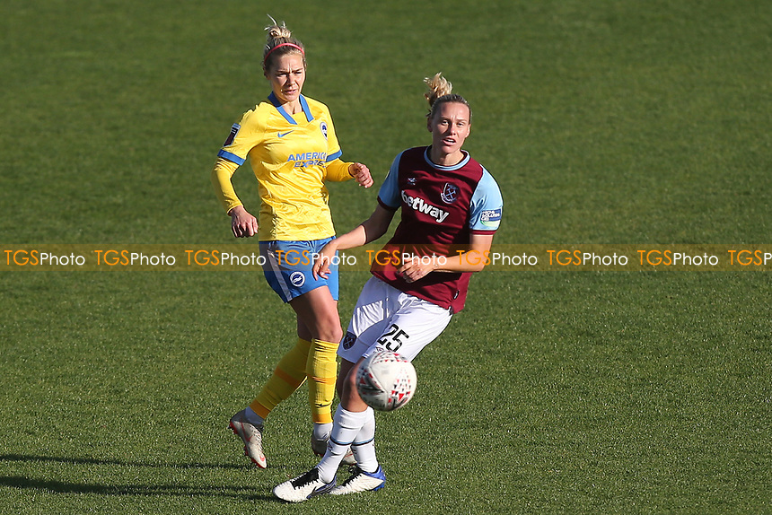 Emily van Egmond of West Ham and Emily Simpkins of Brighton during West Ham United Women vs Brighton & Hove Albion Women, Barclays FA Women's Super League Football at the Chigwell Construction Stadium on 15th November 2020