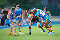 20130803 Copyright onEdition 2013 ©<br /> Free for editorial use image, please credit: onEdition.<br /> <br /> Jeremy Manning of Harlequins 7s is tackled by Tom Varndell of London Wasps 7s during the J.P. Morgan Asset Management Premiership Rugby 7s Series.<br /> <br /> The J.P. Morgan Asset Management Premiership Rugby 7s Series kicks off for the fourth season on Thursday 1st August with Pool A at Kingsholm, Gloucester with Pool B being played at Franklin's Gardens, Northampton on Friday 2nd August, Pool C at Allianz Park, Saracens home ground, on Saturday 3rd August and the Final being played at The Recreation Ground, Bath on Friday 9th August. The innovative tournament, which involves all 12 Premiership Rugby clubs, offers a fantastic platform for some of the country's finest young athletes to be exposed to the excitement, pressures and skills required to compete at an elite level.<br /> <br /> The 12 Premiership Rugby clubs are divided into three groups for the tournament, with the winner and runner up of each regional event going through to the Final. There are six games each evening, with each match consisting of two 7 minute halves with a 2 minute break at half time.<br /> <br /> For additional images please go to: http://www.w-w-i.com/jp_morgan_premiership_sevens/<br /> <br /> For press contacts contact: Beth Begg at brandRapport on D: +44 (0)20 7932 5813 M: +44 (0)7900 88231 E: BBegg@brand-rapport.com<br /> <br /> If you require a higher resolution image or you have any other onEdition photographic enquiries, please contact onEdition on 0845 900 2 900 or email info@onEdition.com<br /> This image is copyright the onEdition 2013©.<br /> <br /> This image has been supplied by onEdition and must be credited onEdition. The author is asserting his full Moral rights in relation to the publication of this image. Rights for onward transmission of any image or file is not granted or implied. Changing or deleting Copyright information is illegal as specified in the Co