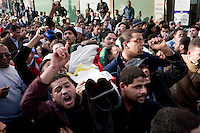Protesters carry the body of a man killed in clashes with police at the interior ministry in central Cairo. Continued anti-government protests take place in Cairo calling for President Mubarak to stand down. After dissolving the government, Mubarak still refuses to step down from power.