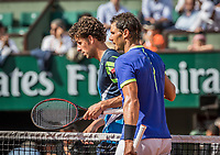 Paris, France, 31 May, 2017, Tennis, French Open, Roland Garros, Robin Haase (NED) (R) congratulates Rafael Nadal (ESP) after his win<br /> Photo: Henk Koster/tennisimages.com