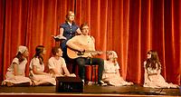 Marc Hayot/Herald Leader. Sierra Horner (left), Kate Kelley, Reece Edwards, Isabelle Pennick, Lindsey Bolstad, and Emma Bryant listen as Clayton Hoskins plays the guitar.