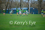 Kerry's Kate Lynch attempts to clear her defence despite the attention from Meaths Aoife Maguire and Leah Dennehy  in the Camogie Intermediate Championship